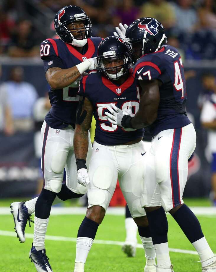 Houston Texans outside linebacker Reshard Cliett (58) is mobbed by teammates after making a play on a third down during the fourth quarter of an NFL game at NRG Stadium, Saturday, Aug. 20, {year}, in Houston. Photo: Karen Warren, Houston Chronicle / 2016 Houston Chronicle