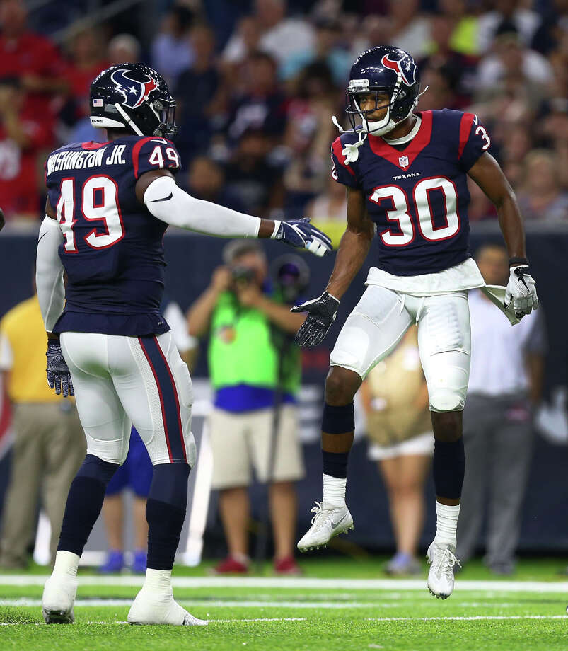 Houston Texans cornerback Kevin Johnson (30) celebrates a stop with outside linebacker Tony Washington (49) during the third quarter of an NFL game at NRG Stadium, Saturday, Aug. 20, {year}, in Houston. Photo: Karen Warren, Houston Chronicle / 2016 Houston Chronicle
