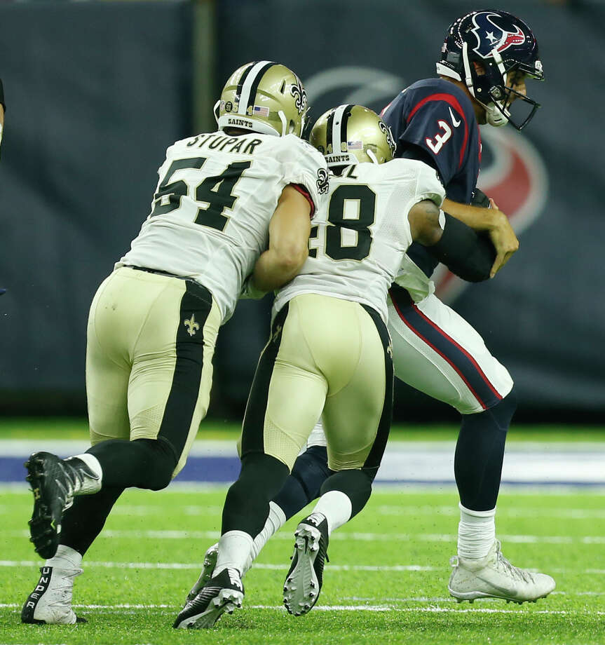 Houston Texans quarterback Tom Savage (3) is sacked by New Orleans Saints linebacker Nate Stupar (54) and free safety Vonn Bell (48) during the fourth quarter of an NFL pre-season football game at NRG Stadium on Saturday, Aug. 20, 2016, in Houston. Photo: Brett Coomer, Houston Chronicle / © 2016 Houston Chronicle