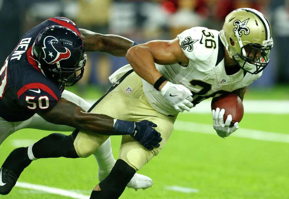 Houston Texans inside linebacker Akeem Dent (50) hits New Orleans Saints running back Daniel Lasco (36) behind the line of scrimmage during the fourth quarter of an NFL pre-season football game at NRG Stadium on Saturday, Aug. 20, 2016, in Houston. Photo: Brett Coomer, Houston Chronicle / © 2016 Houston Chronicle