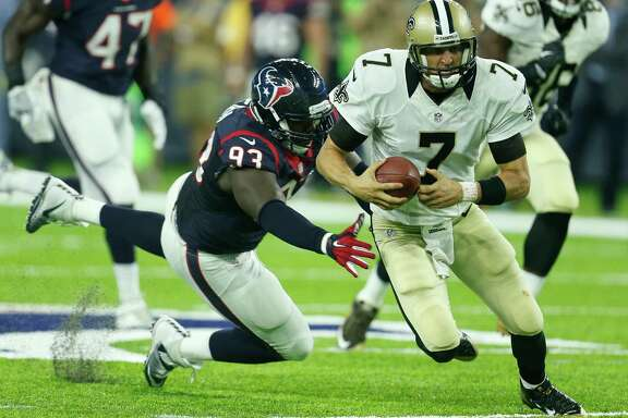 Houston Texans defensive tackle Joel Heath (93) chases down New Orleans Saints quarterback Luke McCown (7) as he is forced out of the pocket during the fourth quarter of an NFL pre-season football game at NRG Stadium on Saturday, Aug. 20, 2016, in Houston.