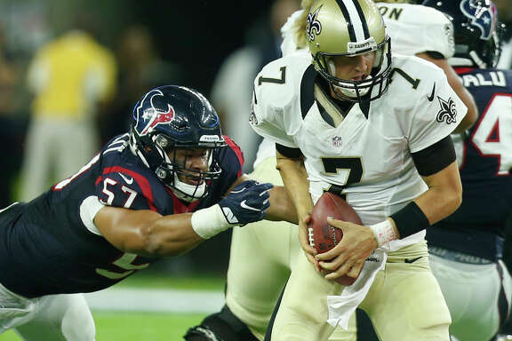Houston Texans linebacker Brennan Scarlett (57) forces New Orleans Saints quarterback Luke McCown (7) out of the pocket during the fourth quarter of an NFL pre-season football game at NRG Stadium on Saturday, Aug. 20, 2016, in Houston.