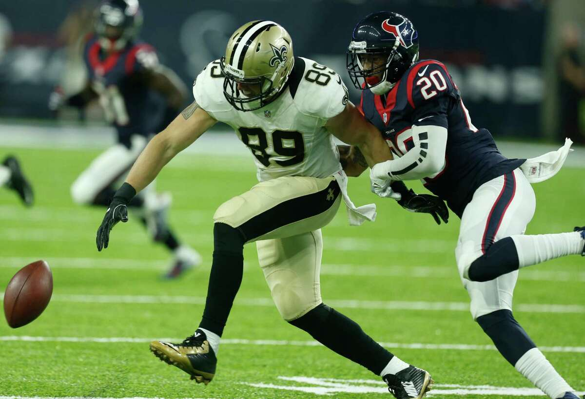 Houston Texans defensive back Antonio Allen (20) breaks up a pass intended for New Orleans Saints tight end Josh Hill (89) during the third quarter of an NFL pre-season football game at NRG Stadium on Saturday, Aug. 20, 2016, in Houston.
