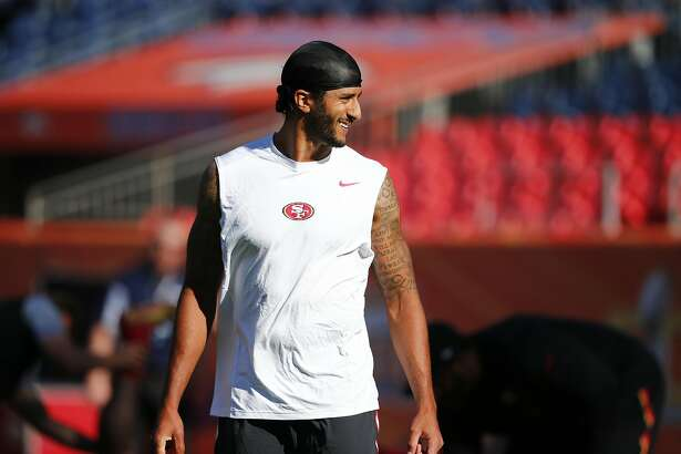 San Francisco 49ers quarterback Colin Kaepernick walks on the field during warmups before a preseason NFL football game against the Denver Broncos, Saturday, Aug. 20, 2016, in Denver. (AP Photo/Jack Dempsey)