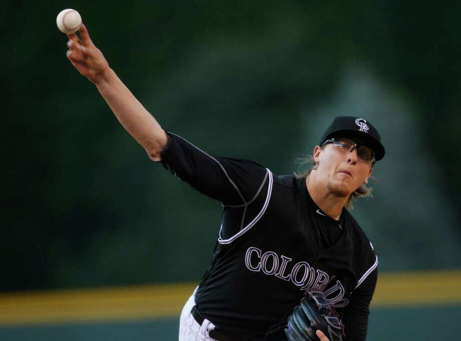 Colorado Rockies starting pitcher Jeff Hoffman delivers a pitch to Chicago Cubs' Anthony Rizzo during the first inning of a baseball game Saturday, Aug. 20, 2016 in Denver. Hoffamn was making his first appearance in the majors. (AP Photo/David Zalubowski) ORG XMIT: CODZ102 Photo: David Zalubowski / Copyright 2016 The Associated Press. All rights reserved. This m