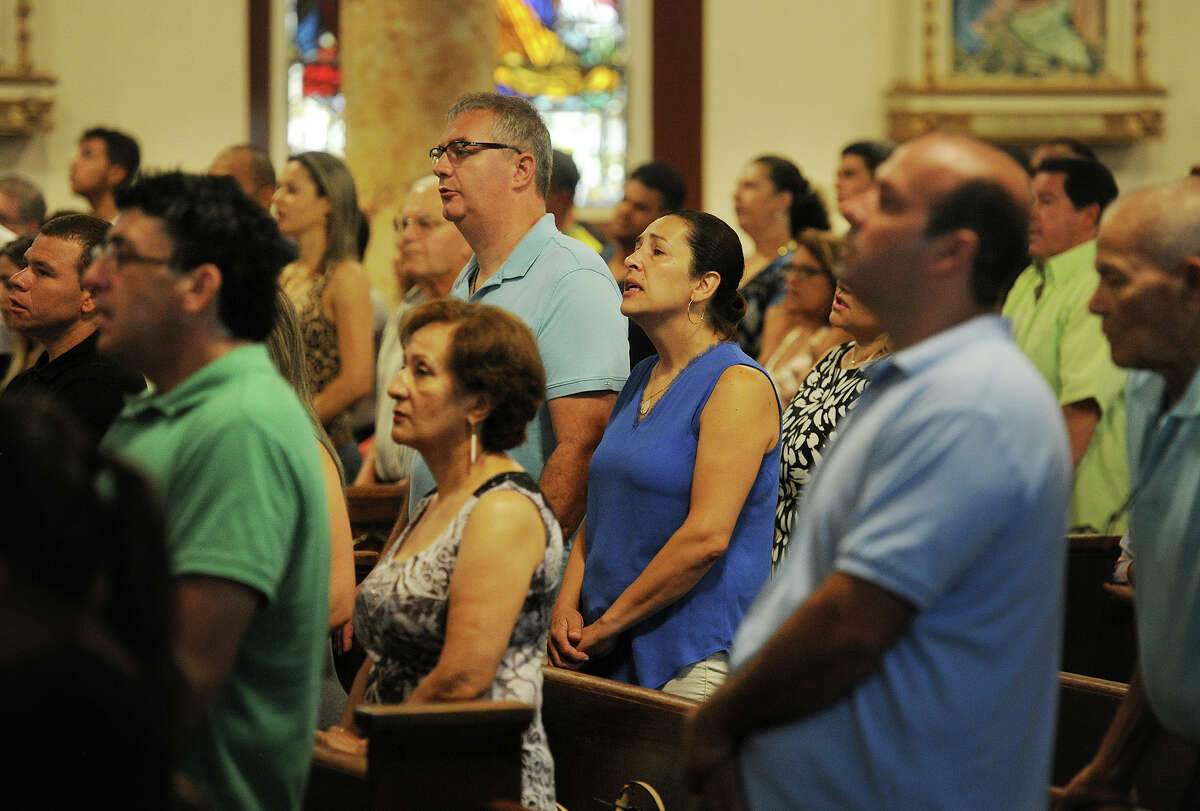Worshippers take part in the morning Mass, held in Brazilian Portugues, at St. Charles Borromeo Catholic Church in Bridgeport last Sunday.