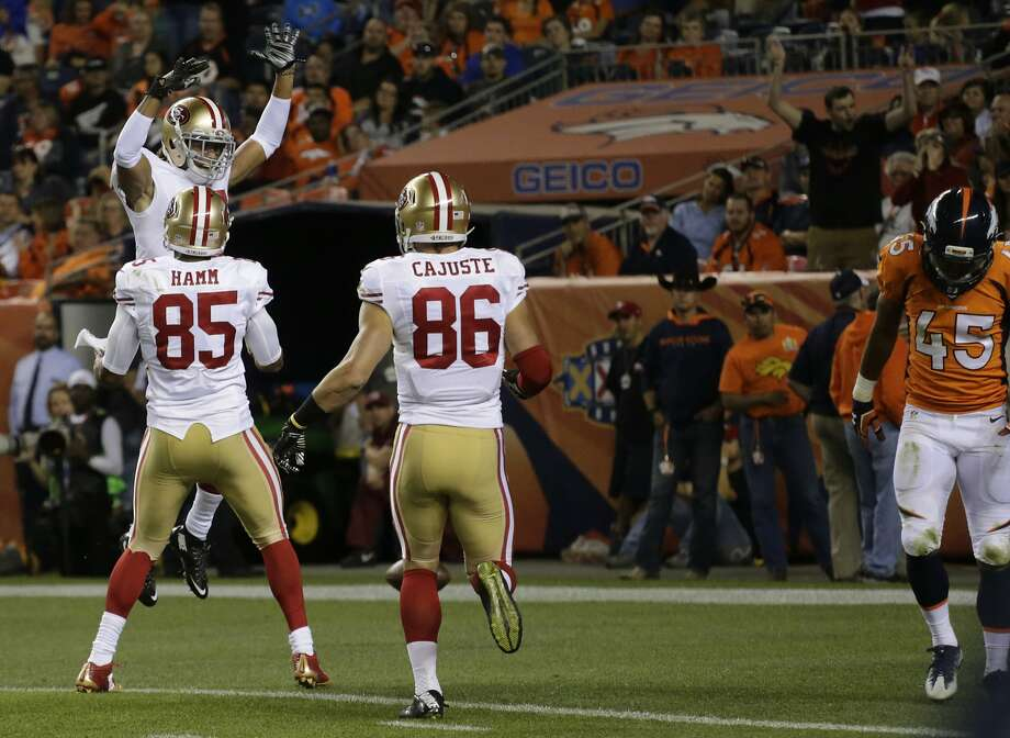 Wide receiver Dres Anderson (upper left) of the 49ers celebrates with teammates after catching a pass for a touchdown during the second half. Left, 49ers quarterback Blaine Gabbert greets Denver counterpart Mark Sanchez postgame. Photo: Jack Dempsey, Associated Press