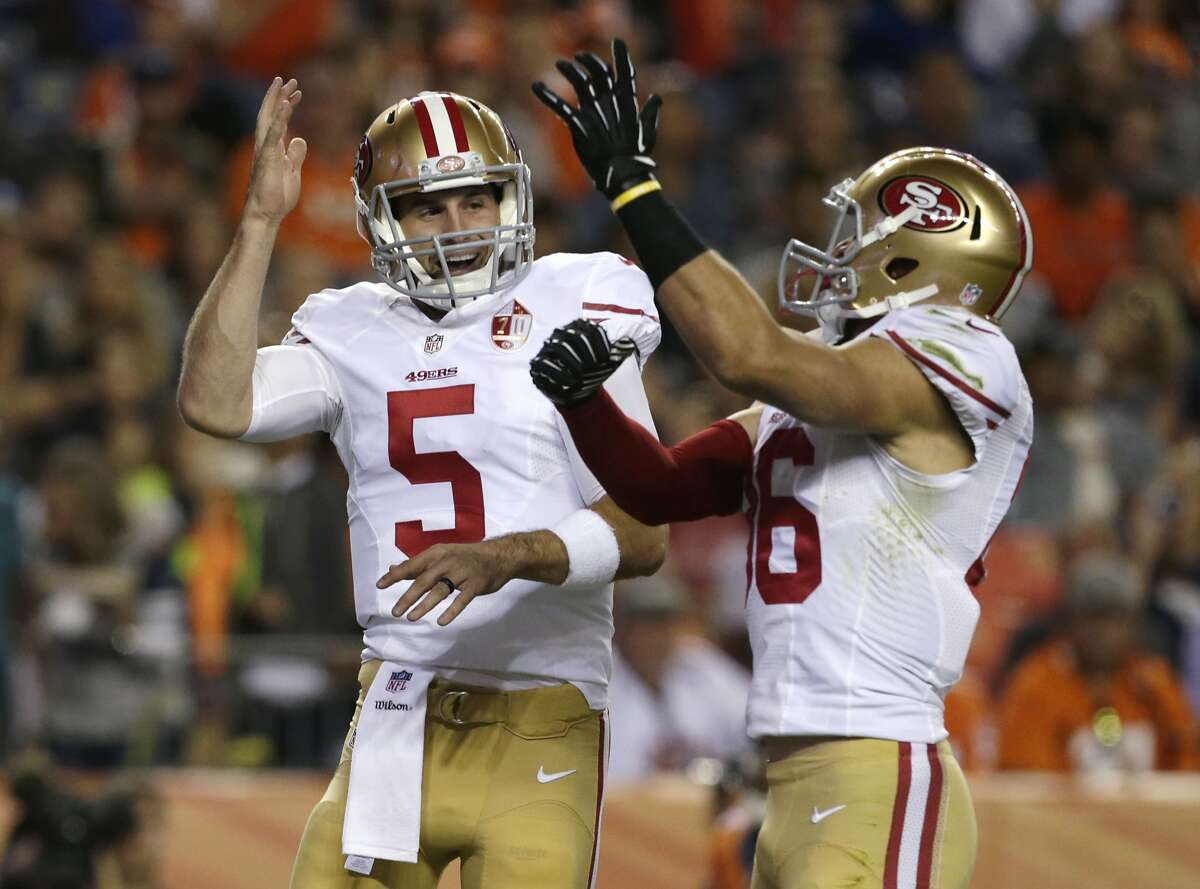 San Francisco 49ers quarterback Christian Ponder, left, celebrates with wide receiver Devon Cajuste after Ponder ran for a touchdown during the second half of a preseason NFL football game against the Denver Broncos, Saturday, Aug. 20, 2016, in Denver.(AP Photo/Joe Mahoney)