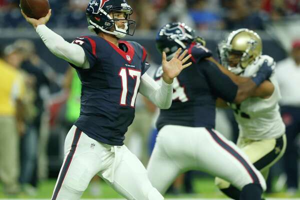 Texans quarterback Brock Osweiler throws a pass against the Saints during the first quarter Saturday night. Osweiler was 12-for-19 for 124 yards and a touchdown in the Texans' 16-9 win.