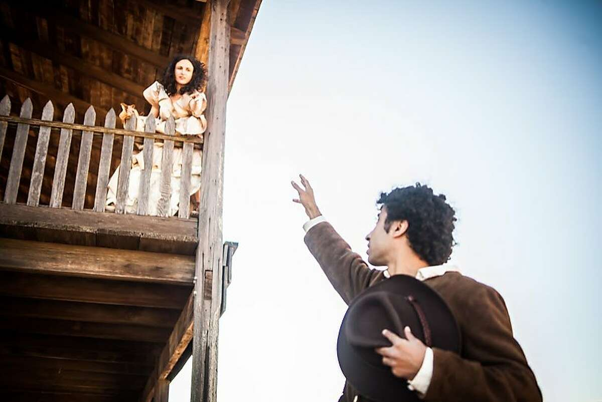 Juliet (Maria Leigh, left) and Romeo (Mohammad Shehata) in the balcony scene.