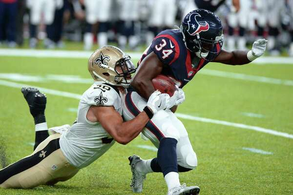 New Orleans Saints running back Daniel Lasco (36) brings Houston Texans running back Tyler Ervin (34) down in the second half of an NFL preseason football game in Houston, Saturday, Aug. 20, 2016. (AP Photo/George Bridges)