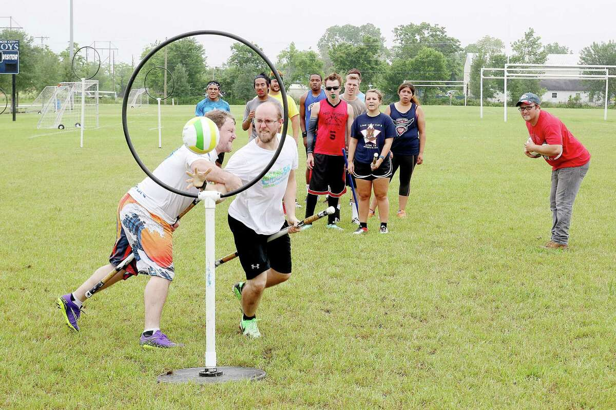 General manager Hank Dugie (right, in red) watches as Quidditch players try out for the League City Legends at Hometown Hero's Park Sunday afternoon. Photo by Pin Lim.