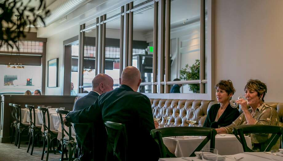 People have dinner at Mason Pacific restaurant. Photo: John Storey, Special To The Chronicle