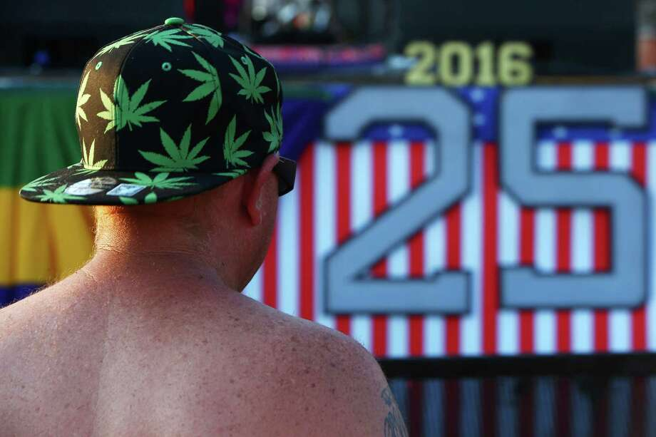 A man listens as Backbone plays the main stage on day two of Hempfest, the annual cannabis freedom festival at Myrtle Edwards Park on the Seattle waterfront. The three day festival is an annual Seattle tradition that started in 1991. This year marks the 25th annual event. Photographed on Saturday, August 20, 2016. Photo: GENNA MARTIN, SEATTLEPI.COM / SEATTLEPI.COM