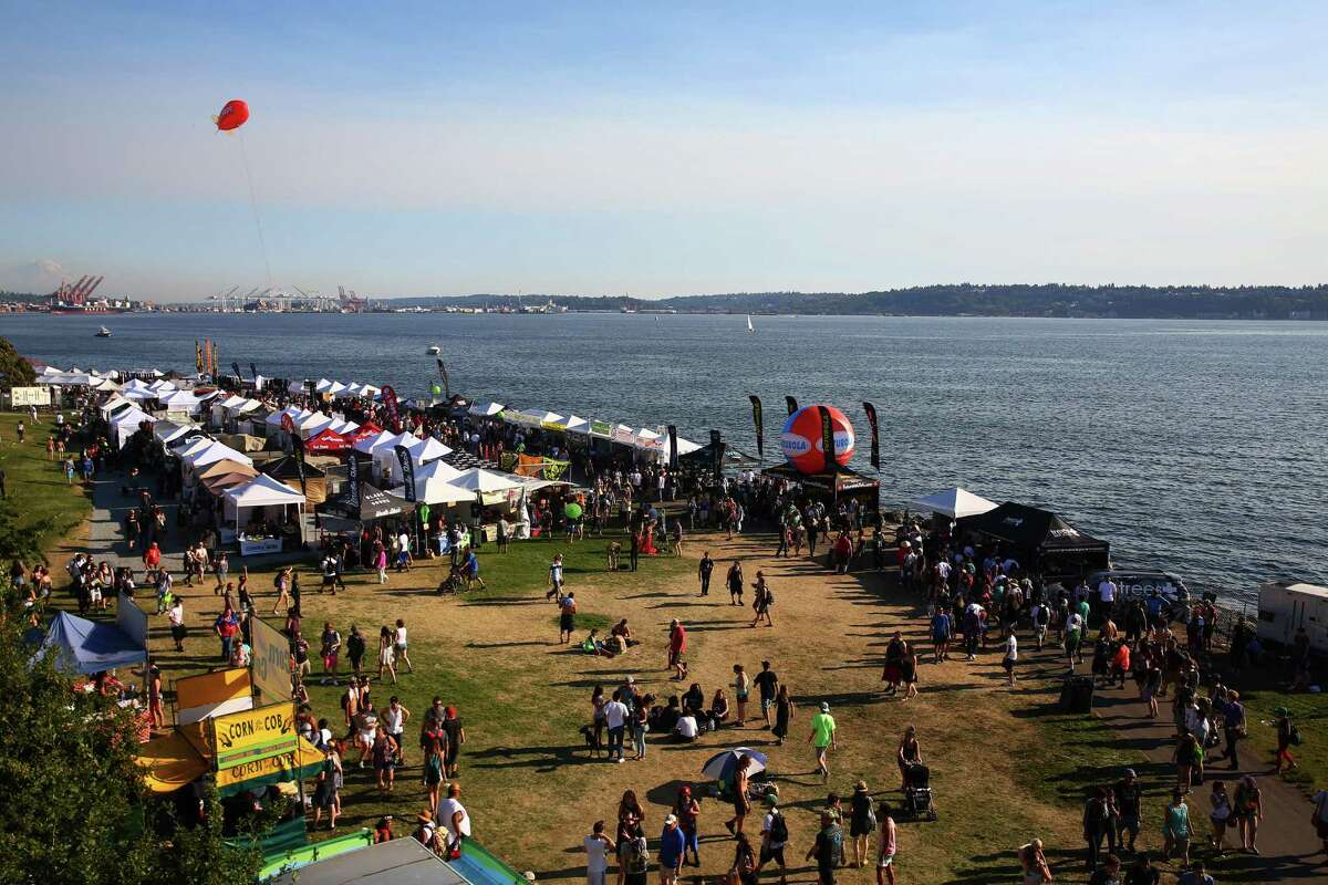 People visit the vendor area on day two of Hempfest, the annual cannabis freedom festival at Myrtle Edwards Park on the Seattle waterfront. The three day festival is an annual Seattle tradition that started in 1991. This year marks the 25th annual event. Photographed on Saturday, August 20, 2016.