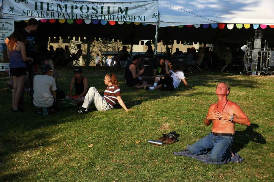 Maxwin Sloane enjoys the sunshine in front of the Hemposium tent on day two of Hempfest, the annual cannabis freedom festival at Myrtle Edwards Park on the Seattle waterfront. Photographed on Saturday, August 20, 2016. Photo: GENNA MARTIN, SEATTLEPI.COM / SEATTLEPI.COM