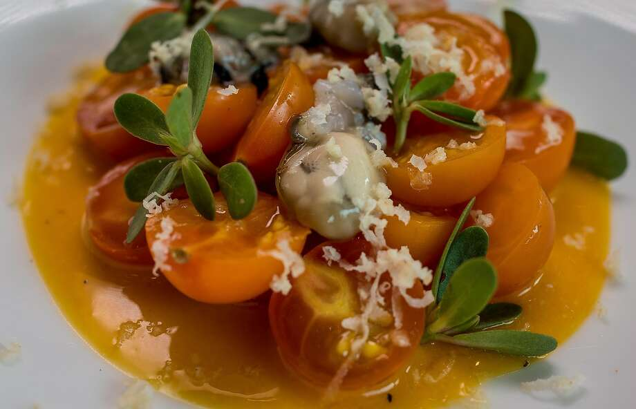 Cherry tomatoes with oysters at Mason Pacific restaurant. Photo: John Storey, Special To The Chronicle