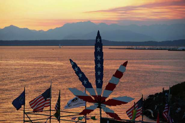 The sunsets behind the main stage on day two of Hempfest, the annual cannabis freedom festival at Myrtle Edwards Park on the Seattle waterfront. The three day festival is an annual Seattle tradition that started in 1991. This year marks the 25th annual event. Photographed on Saturday, August 20, 2016.