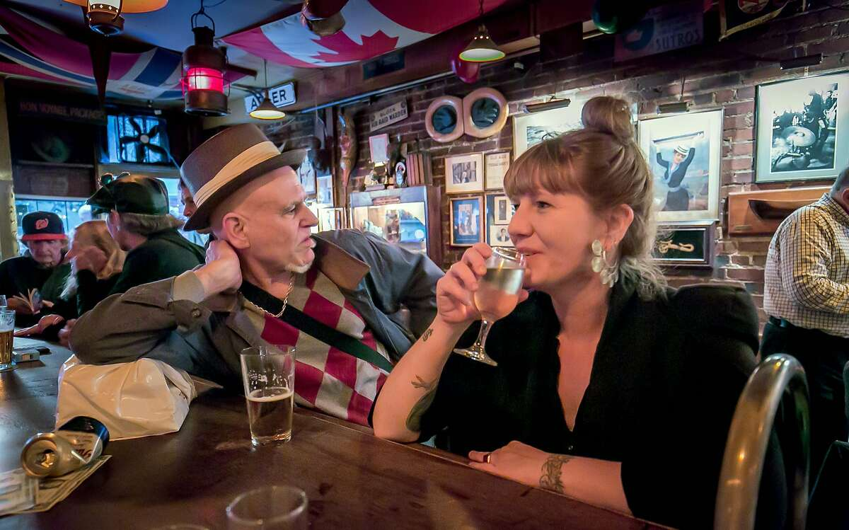 Jack Yaghubian and Joanna Lioce have drinks at Specs in San Francisco, Calif. on August 20th, 2016.
