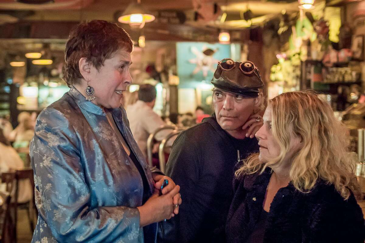 Owner Elly Simmons, left, talks with Gregg Martinez and Jessica Loos at Specs in San Francisco, Calif. on August 20th, 2016.