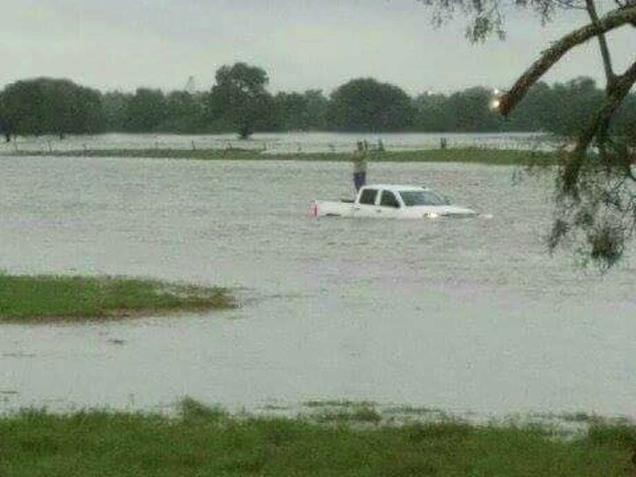 The Karnes County Sheriff's Office reported one high water rescue Sunday morning, Aug. 21, 2016, and multiple road closures throughout the county. Photo: Courtesy Karnes County Sheriff's Office