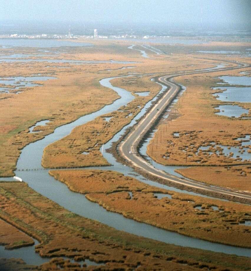 A file photo of Louisiana Route 1 in coastal Louisiana. (AP Photo /John McCusker/The Times-Picayune Photo: JOHN MCCUSKER, AP