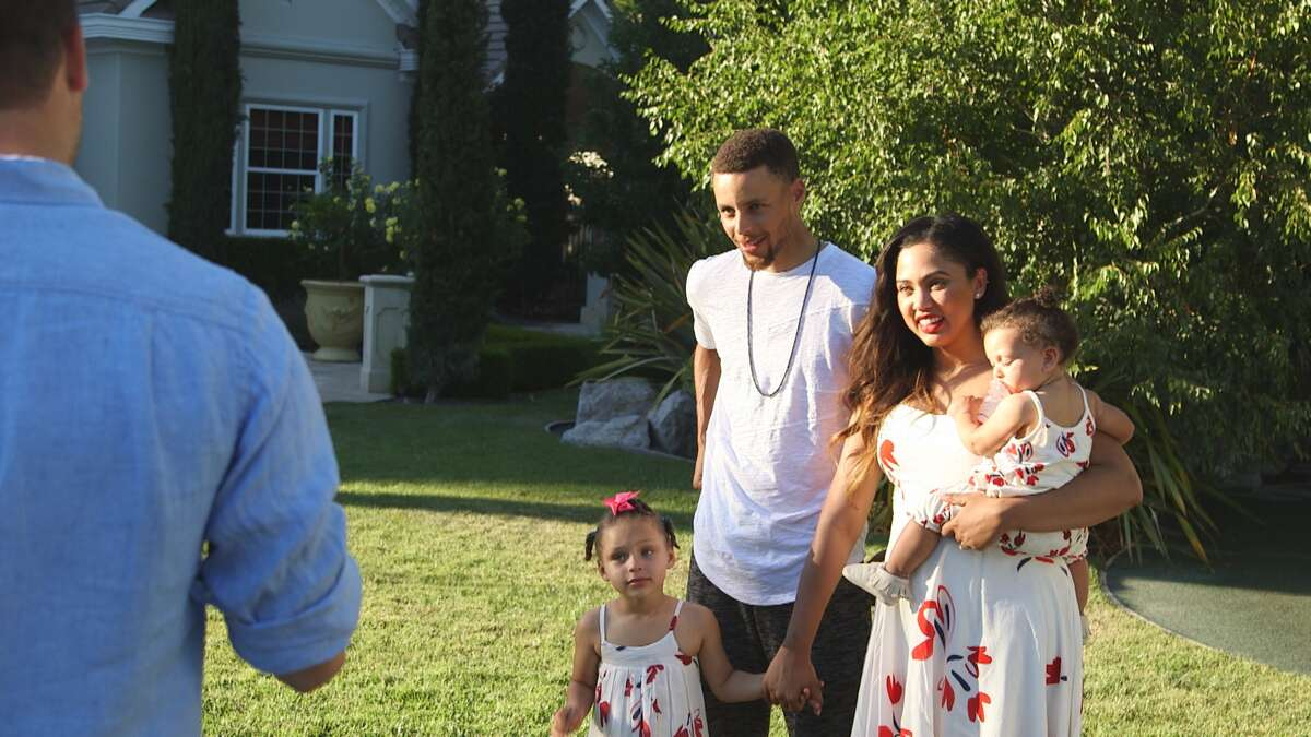 NBA star Stephen Curry with wife Ayesha and their daughters await the unveiling of their new Charmed Playhouse.