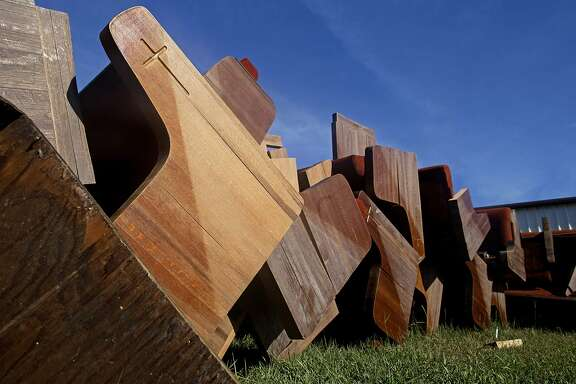 Flood damaged pews from the Christian Fellowship Church sit on the roadside for trash pick up in Walker, La., Sunday, Aug. 21, 2016. Hundreds of residents were rescued from flooded homes in the area last Saturday. (AP Photo/Max Becherer)