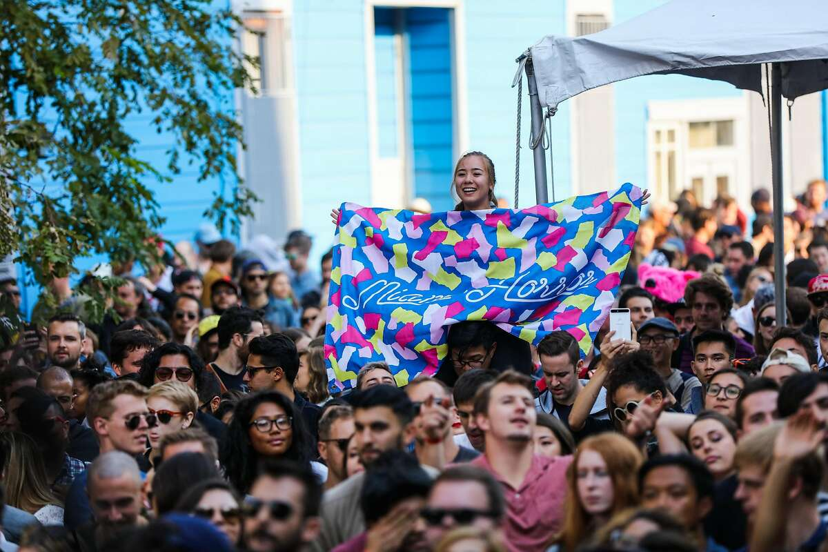A fan holds up a towel to show her support for band Miami Horror as they perform at the 20th Street Block Party music festival in San Francisco, California, on Saturday, Aug. 20, 2016.
