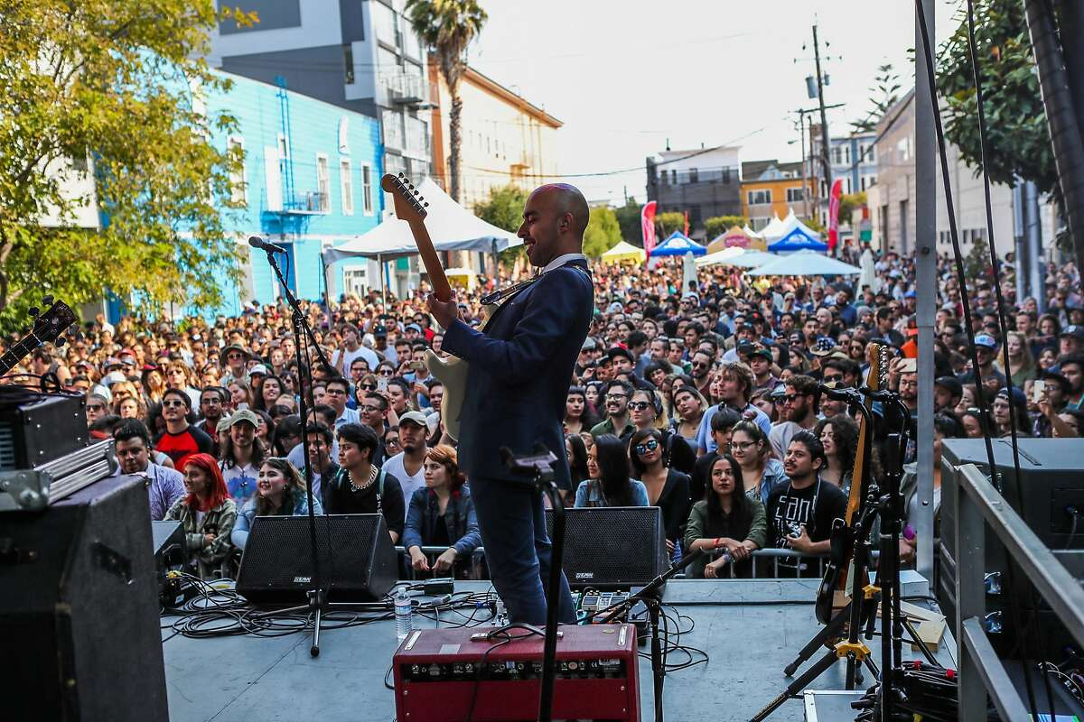 Guitarist Carlos Arevalo, of Chicano Batman performs for a large crowd at the 20th Street Block Party music festival in San Francisco, California, on Saturday, Aug. 20, 2016.