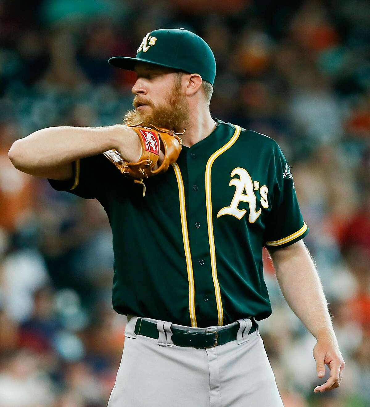 HOUSTON, TX - JUNE 05: Sean Doolittle #62 of the Oakland Athletics looks in before his delivery in the seventh inning against the Houston Astros at Minute Maid Park on June 5, 2016 in Houston, Texas. (Photo by Bob Levey/Getty Images)