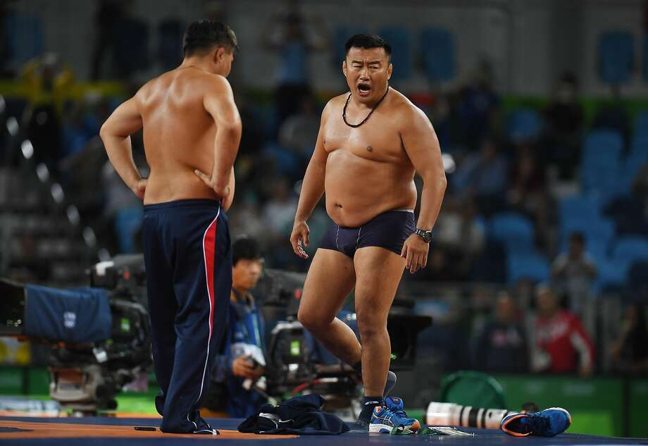 Mongolias coaches protest the judges decision after Mandakhnaran Ganzorig (red) of Mongolia is defeated by Ikhtiyor Navruzov (blue) of Uzbekistan in the Men's Freestyle 65kg Bronze match against  on Day 16 of the Rio 2016 Olympic Games at Carioca Arena 2 on August 21, 2016 in Rio de Janeiro, Brazil.  (Photo by Laurence Griffiths/Getty Images) Photo: Laurence Griffiths, Getty Images