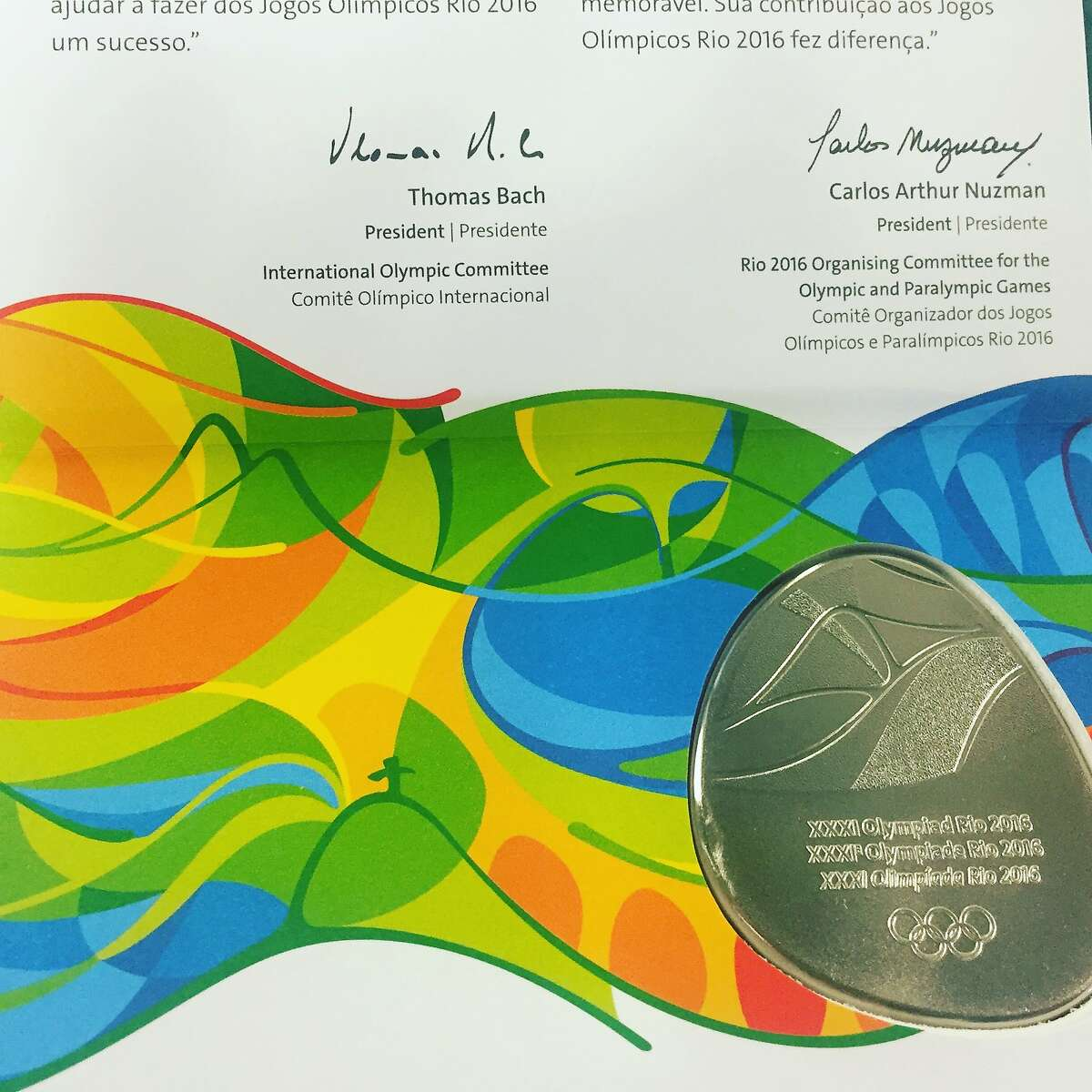 Media are awarded a medal for covering the 2016 Games