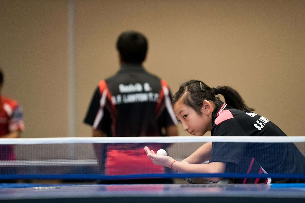 11-year-old Emilie Yin plays a game of Ping Pong at the Hilton in the Financial District of San Francisco Calif. on Sunday, Aug. 21, 2016. The San Francisco Chinatown Ping Pong Festival brings teams from around the Bay Area to compete.