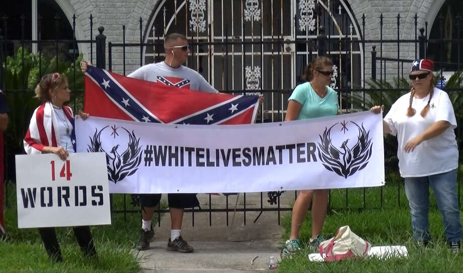 "FILE - Protesters display a ""White Lives Matter"" sign in front of an NAACP office in Houston, Texas on Aug. 21, 2016. The label and associated persons were declared a ""hate group"" by the Southern Poverty Law Center shortly after. Photo: Metro Video"
