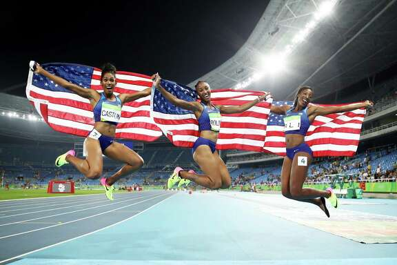 The 100-meter hurdles produced an American sweep by, from left, bronze medalist Kristi Castlin, gold medalist Brianna Rollins and silver medalist Nia Ali.