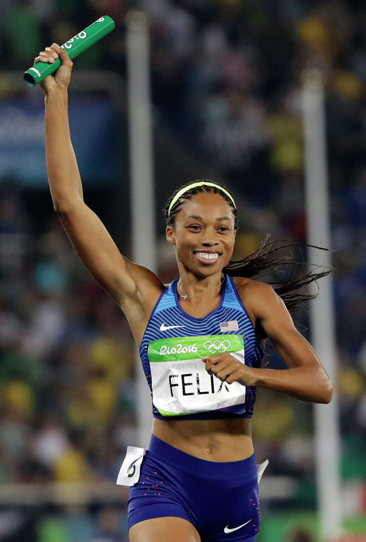 United States' Allyson Felix crosses the line to win the gold medal in the women's 4x400-meter relay final during the athletics competitions of the 2016 Summer Olympics at the Olympic stadium in Rio de Janeiro, Brazil, Saturday, Aug. 20, 2016. (AP Photo/David J. Phillip)