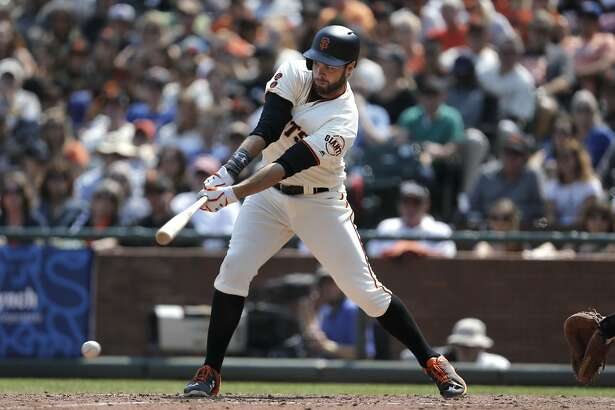 Giants' Brandon Belt grounds int o a single as the San Francisco Giants take on the New York Mets at AT&T Park in San Francisco , California, on Sat. Aug. 20, 2016.