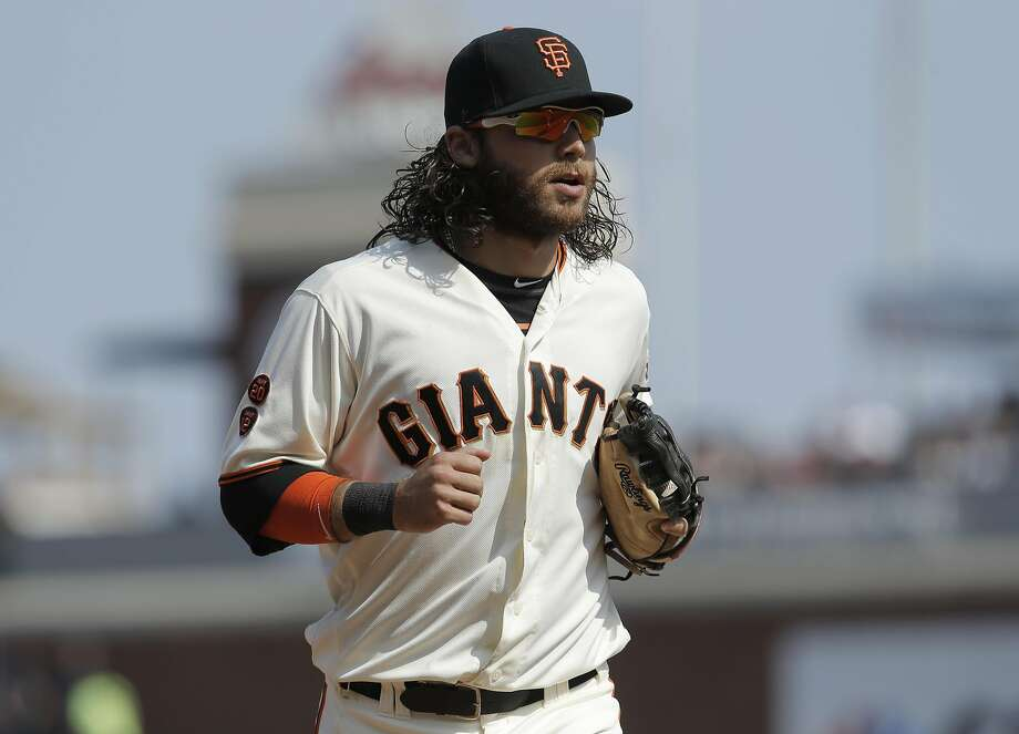 Giants' Brandon Crawford hustles off the field at the end of the 8th inning, as the San Francisco Giants take on the New York Mets at AT&T Park in San Francisco on Aug. 20. Photo: Michael Macor, The Chronicle