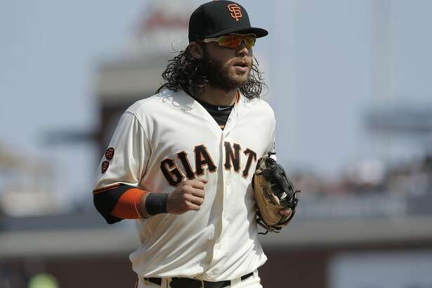 Giants' Brandon Crawford hustles off the field at the end o the 8th inning, as the San Francisco Giants take on the New York Mets at AT&T Park in San Francisco , California, on Sat. Aug. 20, 2016.