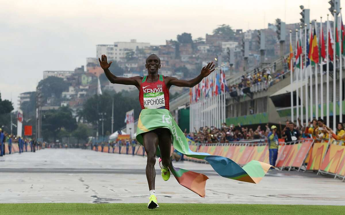 Kenya's Eliud Kipchoge crosses the finish line to win the men's marathon at the 2016 Summer Olympics in Rio de Janeiro, Brazil, Sunday, Aug. 21, 2016. (AP Photo/Petr David Josek)