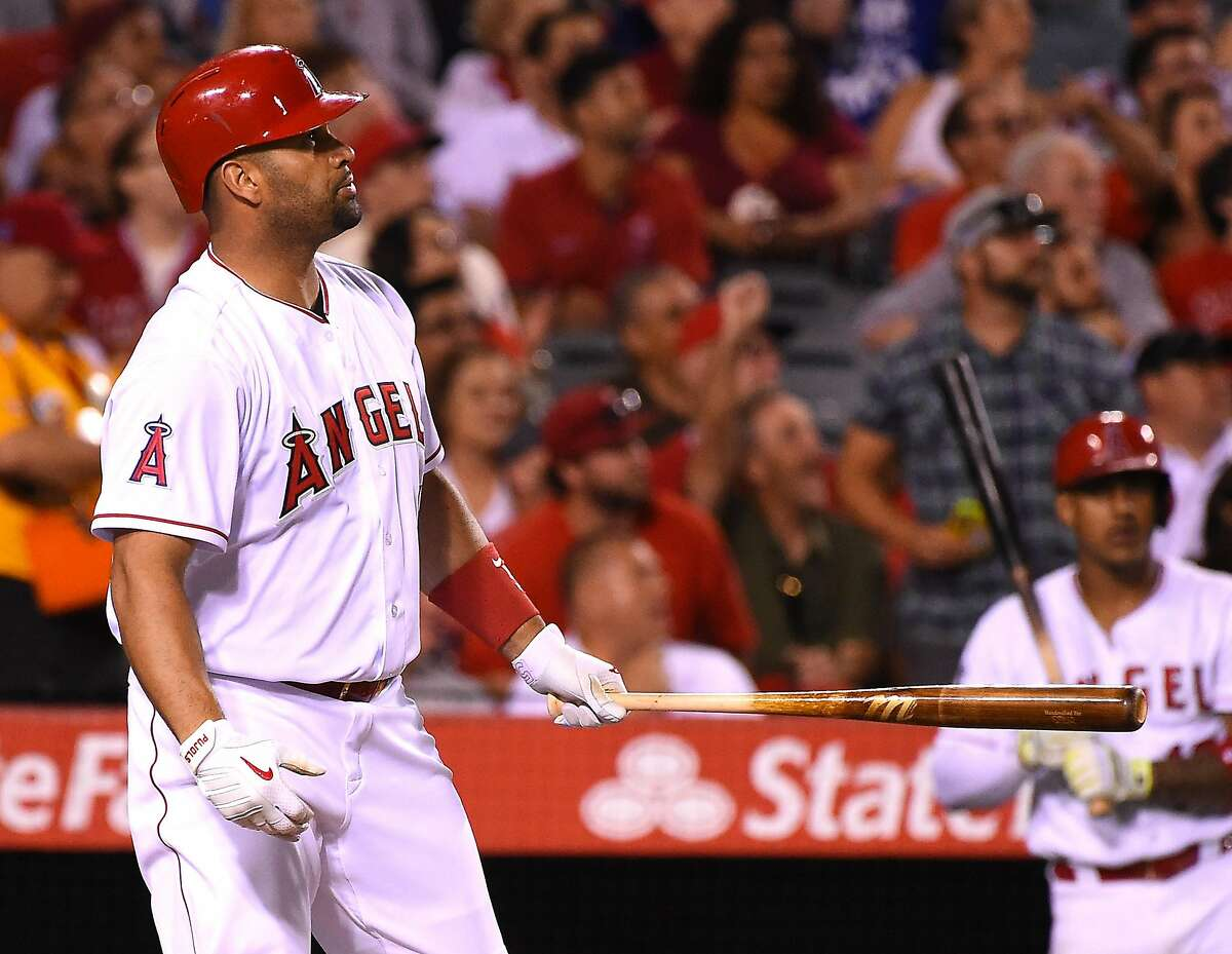 ANAHEIM, CA - AUGUST 16: Albert Pujols #5 of the Los Angeles Angels watches the ball leave the park for a 3 run home run in the sixth inning of the game against the Los Angeles Angels at Angel Stadium of Anaheim on August 16, 2016 in Anaheim, California. (Photo by Jayne Kamin-Oncea/Getty Images)