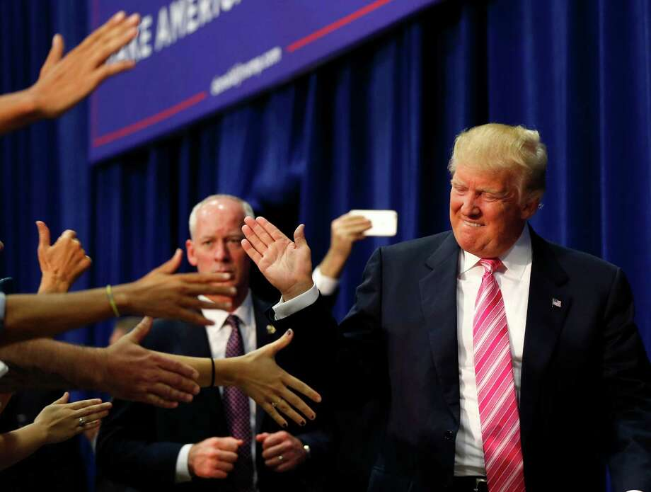 Republican presidential candidate Donald Trump arrives to speak at a campaign rally in Fredericksburg, Va., Saturday, Aug. 20, 2016. (AP Photo/Gerald Herbert) ORG XMIT: VAGH117 Photo: Gerald Herbert / Copyright 2016 The Associated Press. All rights reserved. This m