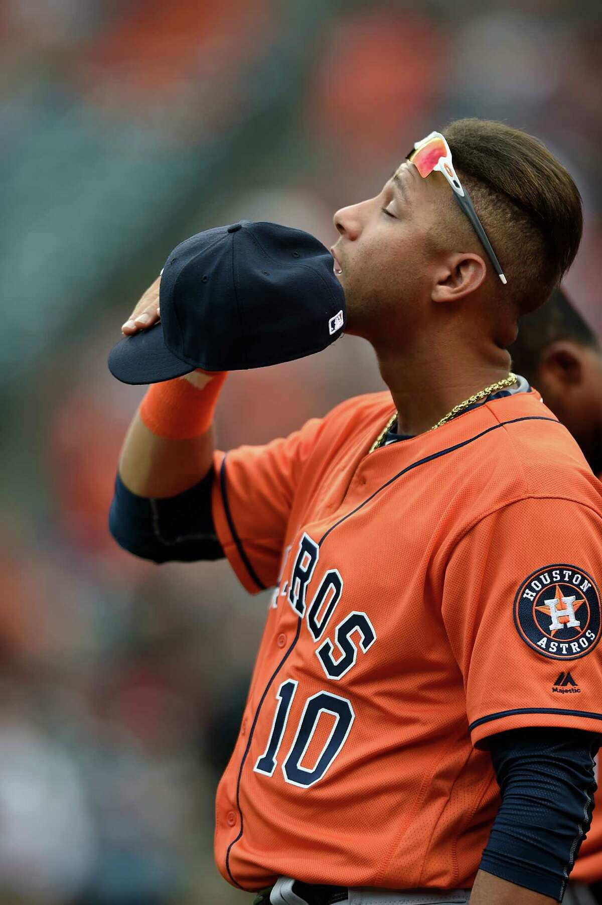 Houston Astros Yulieski Gurriel closes his eyes during the National Anthem before playing the Baltimore Orioles in a baseball game, Sunday, Aug. 21, 2016, in Baltimore. (AP Photo/Gail Burton)