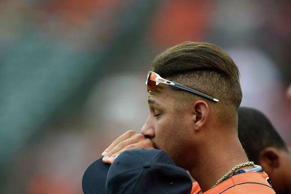 Houston Astros Yulieski Gurriel during the National Anthem before playing the Baltimore Orioles in a baseball game, Sunday, Aug. 21, 2016, in Baltimore. (AP Photo/Gail Burton)