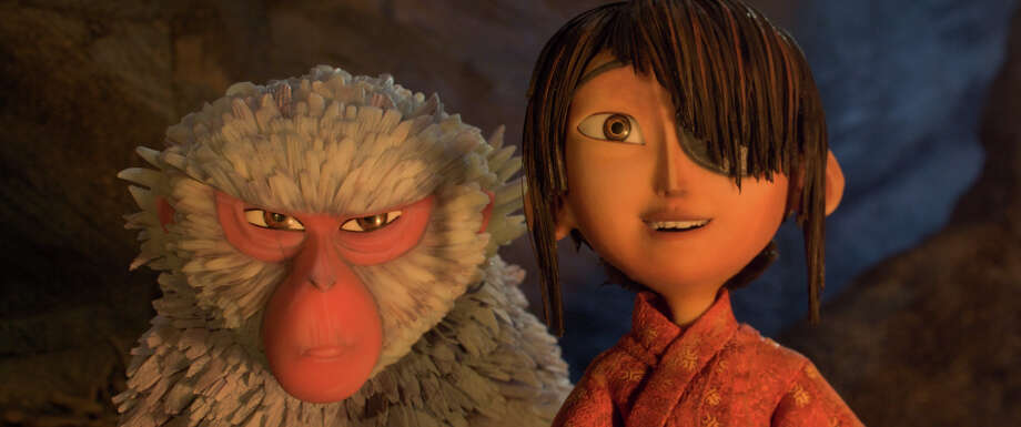 "This image released by Focus Features shows characters Kubo, voiced by Art Parkinson, right, and Monkey, voiced by Charlize Theron in a scene from the animated film, ""Kubo and the Two Strings."" (Laika Studios/Focus Features via AP) ORG XMIT: NYET114 / 2016 LAIKA, Inc / Focus Features"