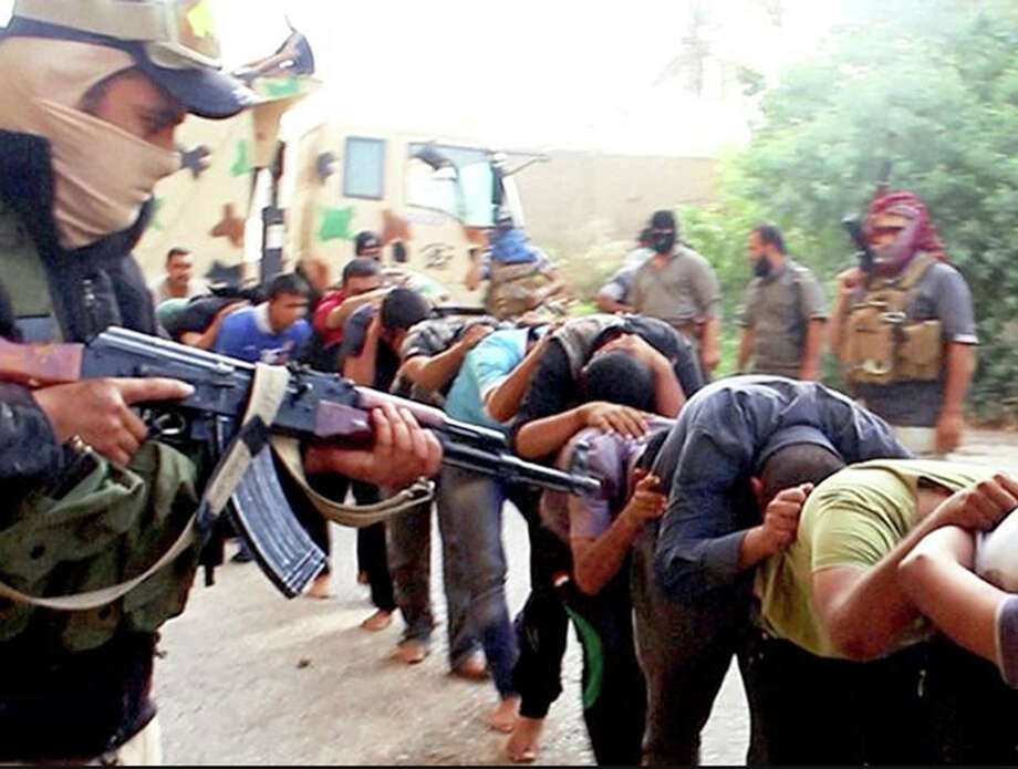 FILE -This image posted online by Islamic State militants on June 14, 2014 shows Iraqi cadets captured by IS moments before they were killed in Tikrit, Iraq. Iraqi officials say the country has executed 36 men on Sunday, Aug. 21, 2016 convicted of taking part in the Islamic State group's massacre of hundreds of soldiers in 2014.(militant photo via AP, File) ORG XMIT: XMA102 / militant photo