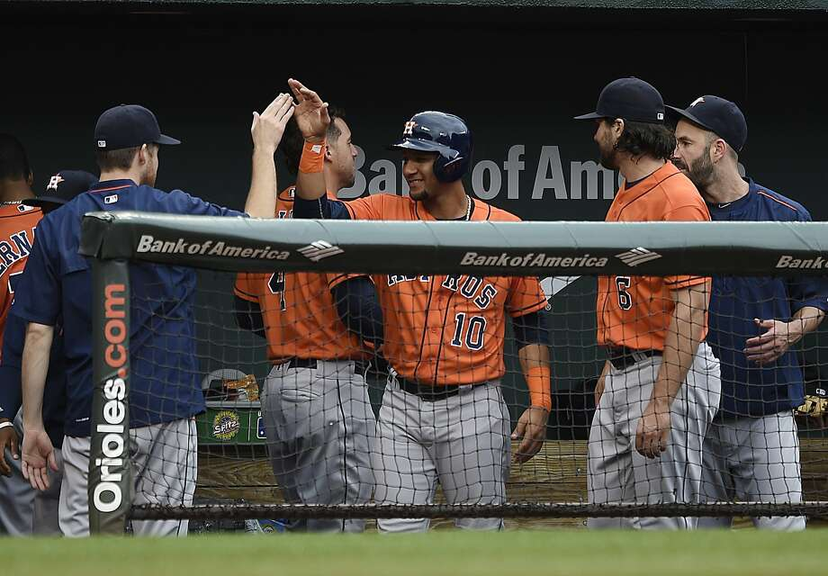 Houston Astros' Yulieski Gurriel, center, is congratulated by his team in the second inning of a baseball game after hitting a single in his major league debut against the Baltimore Orioles, Sunday, Aug. 21, 2016, in Baltimore. (AP Photo/Gail Burton) Photo: Gail Burton, Associated Press