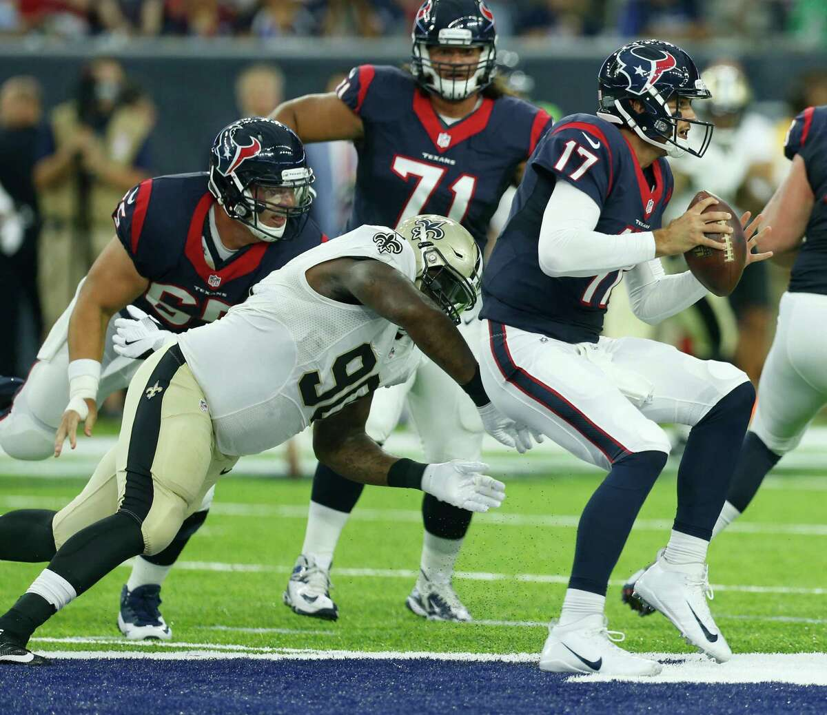 New Orleans defensive tackle Nick Fairley (90) beats Texans center Greg Mancz, left, and sacks Brock Osweiler in the first half Saturday. Mancz was thrust into his starting role when Nick Martin missed the game because of an ankle injury.