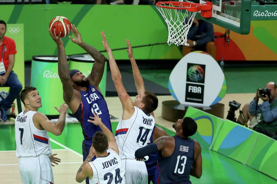 RIO DE JANEIRO, BRAZIL - AUGUST 21:  Demarcus Cousins #12 of United States shoots the ball over Nikola Jokic #14 of Serbia during the Men's Bronze medal game on Day 16 of the Rio 2016 Olympic Games at Carioca Arena 1 on August 21, 2016 in Rio de Janeiro, Brazil.  (Photo by Christian Petersen/Getty Images) ORG XMIT: 610602361 Photo: Christian Petersen / 2016 Getty Images